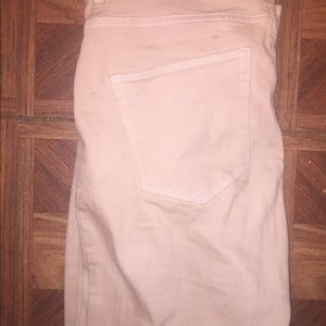 Peach colored high waisted jeans