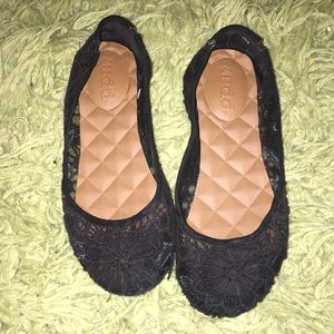 Black lace covered flats