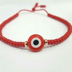 14k Yellow Gold red bead evil eye braclet