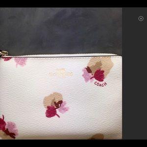 Coach Field flora wristlet in chalk rose color