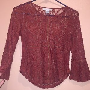 I'm selling a flower printed see through blouse