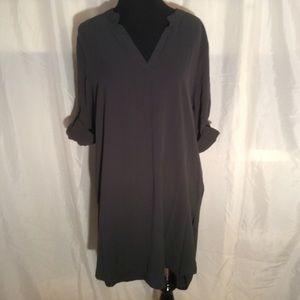 Dark grey v-neck tunic.