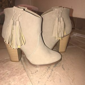 Western style heeled booties with fringe detail
