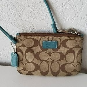 COACH tan/turquoise with silver hardware wristlet