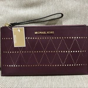 NWT Plum/Gold Michael Kors Perforated Zip Clutch