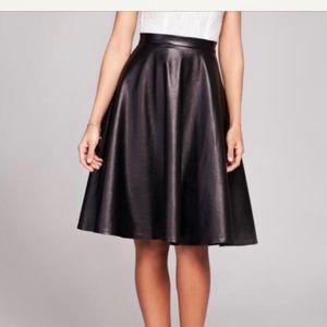 Black faux leather knee length flared skirt
