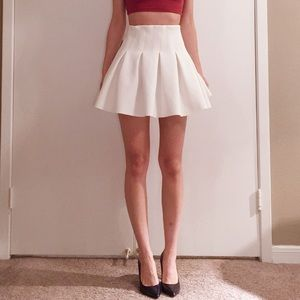 Lovers + Friends white pleated circle skirt.