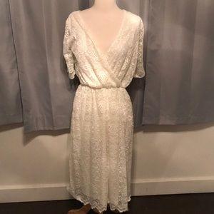 Beautiful white lace cross over Dress