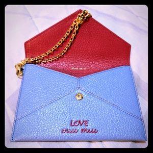 Miu Miu Baby Blue Clutch with gold Strap
