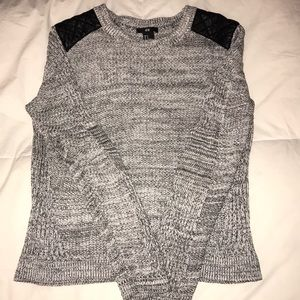 Gray H&M sweater with black faux leather shoulder