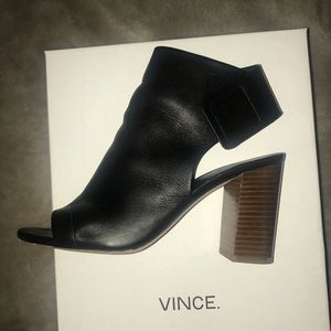 Black leather peep-toe booties by Vince