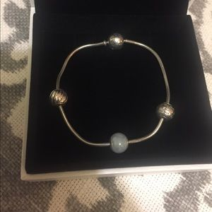 Pandora Essence Bracelet with 3 charms.