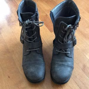 Grey combat style boots.