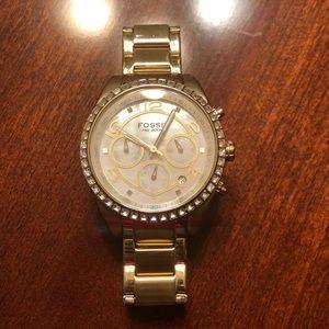 Women's gold fossil watch