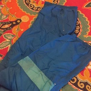 Men's blue and teal Nike wind pants