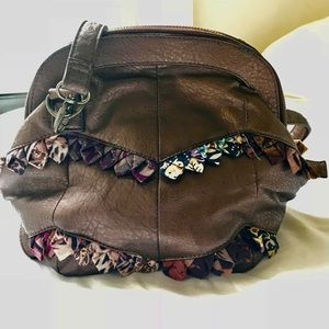 Bubble shaped hold-all upcycled leather bag.