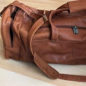 Vintage orange/brown leather travel bag