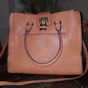 Light brown purse w golden accents.