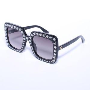 Gucci GG0148s 001 Black Sunglasses