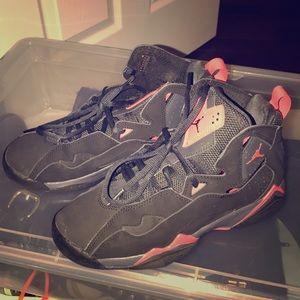 Black and pink Jordan's