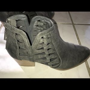 Light grey cut out booties with zipper back.