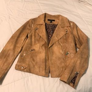 Tan fake leather jacket with gold zippers