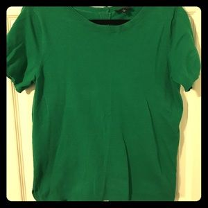 Green short sleeved top with buttons down the back