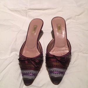Prada ribbon kitten heeled shoes.