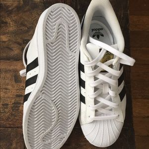 Brand new Adidas Superstar shell toe trainers.