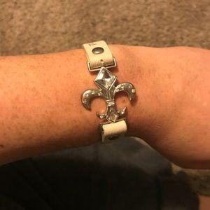 Small fleur de lis on leather bracelet
