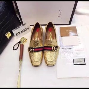 Women's gold Gucci shoes