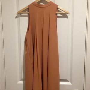 Knee length fall colored dress.