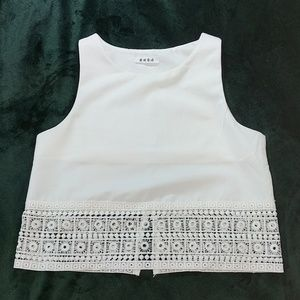 Sleeveless white crop top with lace trim