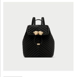 Zara Quilted Backpack with Lion Detail