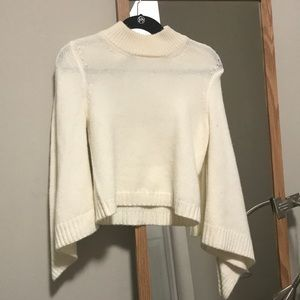 White turtleneck sweater with flared sleeves