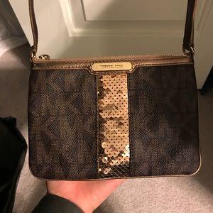 Michael Kors crossbody purse.
