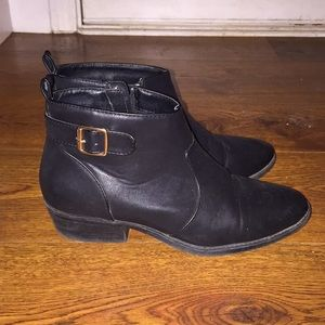 black booties with gold buckle