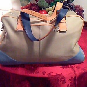 Large Coach canvas travel bag with minor stains