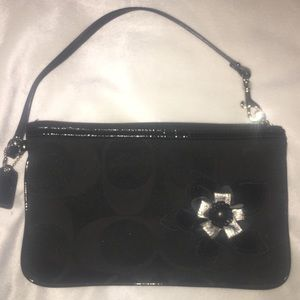 New black COACH wristlet with flower decal!