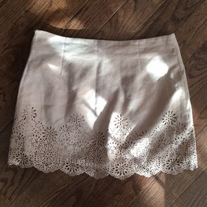 Suede skirt with laser cut design