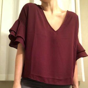 Maroon ruffled blouse