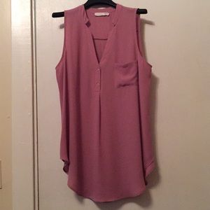 Blush colored sleeveless blouse