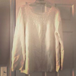 Gorgeous cream sweater with neck embellishments.