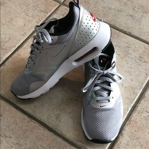 Silver NIKE tennis shoes