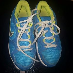 Teal and neon green nike shoes