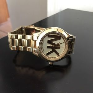 BRAND NEW WITH PLASTIC MK GOLD WATCH!