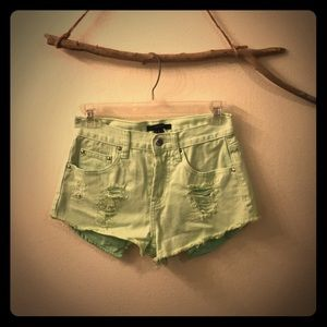 Muted lime green high waisted jean shorts