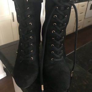 Lace up mid length black boots