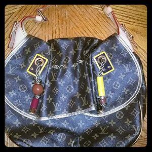 Faux Louie Vuitton Monogram Kalahari Madonna Bag