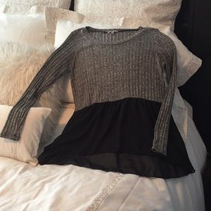 Sweater with sheer black material at the bottom